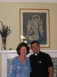 Fr. Jhon and Debbie on Blessing Day. Note batik of St. Luke in background